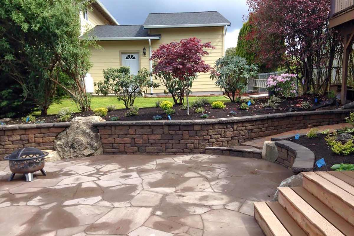 Lavender flagstone patio with Celtik reatining wall